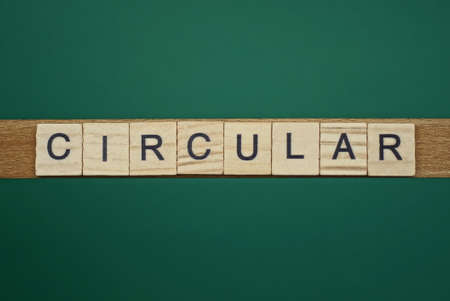 Photo for gray word circular made of wooden square letters on green background - Royalty Free Image