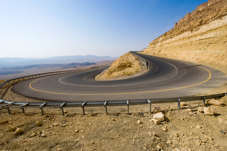 A hairpin bend on a road in the mountains of the negev desert in Israel