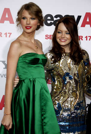 Taylor Swift and Emma Stone at the Los Angeles premiere of 'Easy A' held at the Grauman's Chinese Theater in Hollywood, USA on September 13, 2010.