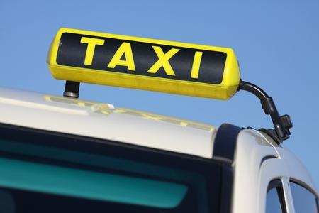 German taxi sign against blue sky