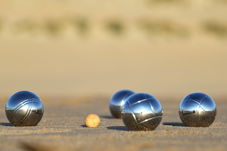 bocce balls on sandy beach