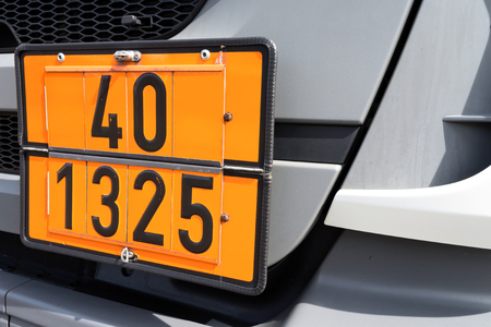 orange-colored plate with hazard-identification number 40 and UN Number 1325 (flammable solids, organic, nos)