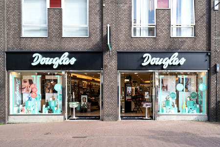 Douglas branch in the city center of Gouda, Netherlands. Douglas is a German perfume and cosmetics retailer and has more than 1,700 stores and franchised outlets across Europe.