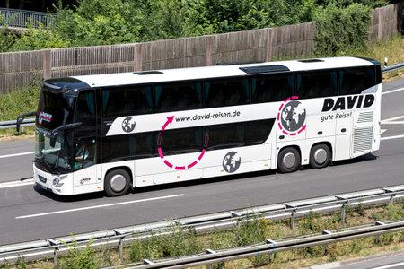 David intercity bus on motorway.