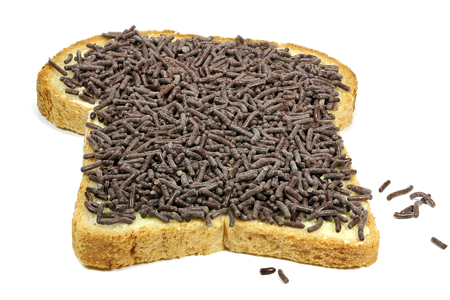 Dutch white bread with hagelslag (chocolate sprinkles) topping isolated on white background