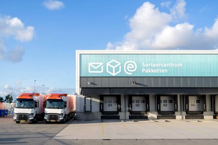 Photo pour PostNL sorting center. PostNL is a mail, parcel and e-commerce corporation with operations in the Netherlands, Germany, Italy, Belgium, and the United Kingdom. - image libre de droit