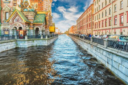 View over Griboyedov Canal Embankment near the iconic Church of the Savior on Spilled Blood, St. Petersburg, Russia