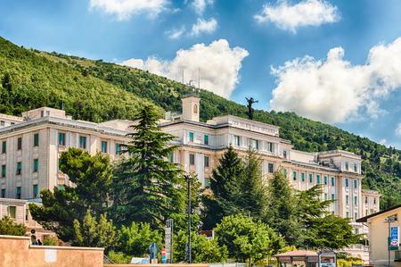 SAN GIOVANNI ROTONDO, ITALY - JUNE 10: Casa Sollievo della Sofferenza, private hospital founded in 1956 by Saint Pio of Pietrelcina, located in San Giovanni Rotondo, Italy, June 10, 2018