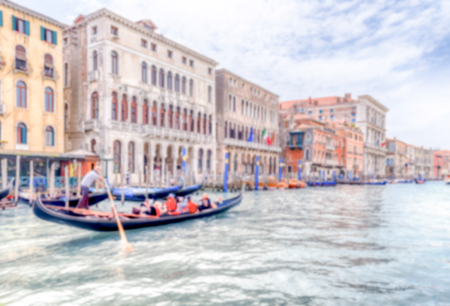 Defocused background with traditional Gondola in Grand Canal, Venice, Italy. Intentionally blurred for bokeh effect
