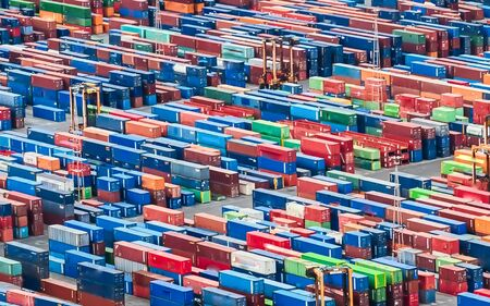 Photo for Texture made with an aerial view over shipping cargo containers stacked on a commercial port. Suitable to be used as background - Royalty Free Image