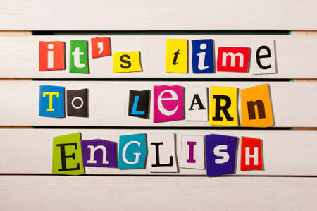 Photo pour learning english concept. it's time to learn English - written with color magazine letter clippings on wooden board. - image libre de droit