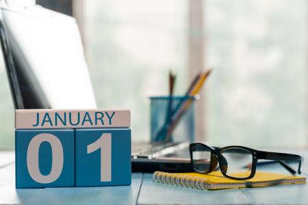 Photo pour January 1st. Day 1 of month, calendar on teacher workplace background. - image libre de droit