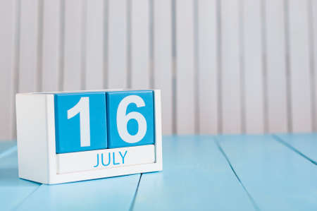 July 16th. Image of july 16 wooden color calendar on white background.
