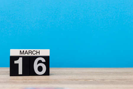 March 16th. Day 16 of march month, calendar on light blue background. Spring time, empty space for text, mockup