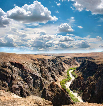 Beautiful river in Charyn canyon and blue sky with clouds in Kazakhstan