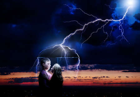Lighting strikes umbrella with Young couple under it at night storm sky background. Represents sparkle between two lovers の写真素材