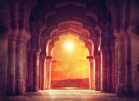 Old ruined arch in ancient temple at sunset in India
