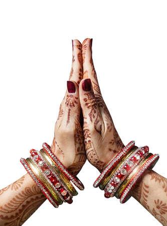 Foto de Woman hands with henna in Namaste mudra on white background - Imagen libre de derechos