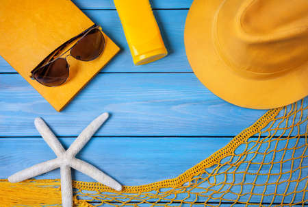Summer holiday stuff on blue wooden background