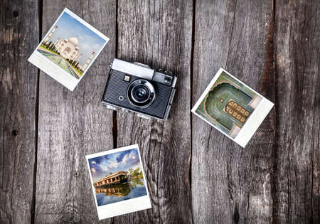 Old film camera and   photos with Indian famous landmarks on the wooden background