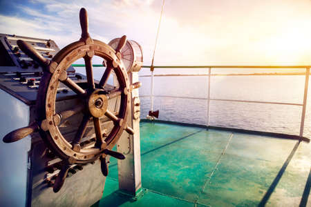 Photo for Wooden wheel on the ship at sunset on Issyk Kul lake - Royalty Free Image