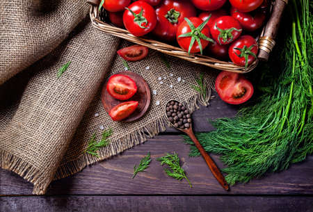 Photo pour Spoon with black pepper, tomato, herbs on the wooden table - image libre de droit