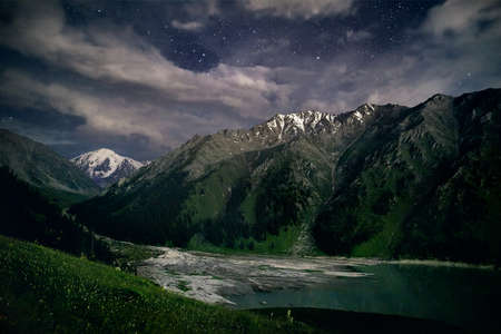 Photo for Big Almaty Mountain Lake in Tien Shan Mountains under nigh starry sky in Kazakhstan - Royalty Free Image