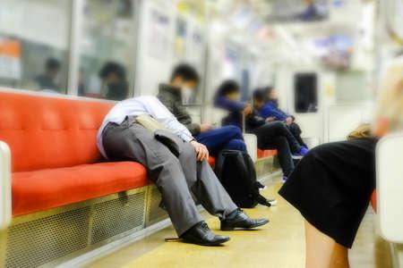 Man sleeps on subway train in Japan