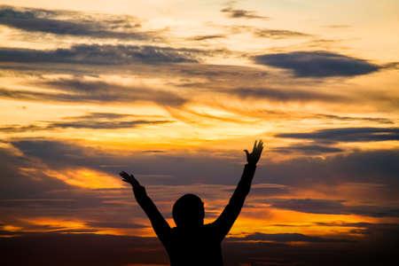 Hands raised like praying or worshiping
