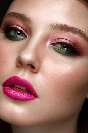 Photo pour Beautiful girl with creative colorful make up. Beauty face. Photos shot in studio - image libre de droit