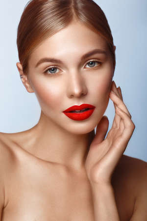 Photo pour Beautiful girl with red lips and classic makeup. Beauty face. Photo taken in the studio. - image libre de droit