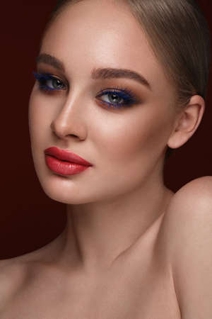 Photo pour Beautiful girl with bright fashionable make-up. Beauty face. Photo taken in the studio. - image libre de droit