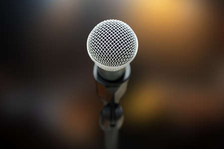 Close-up of microphone in concert hall or conference room