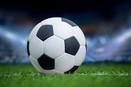 Photo pour Closeup soccer ball in green grass on stadium  - image libre de droit