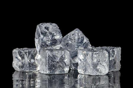 Photo pour Ice cubes square with drops water clean on black background - image libre de droit