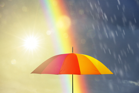 Photo for umbrella at a rainy day with rainbow - Royalty Free Image