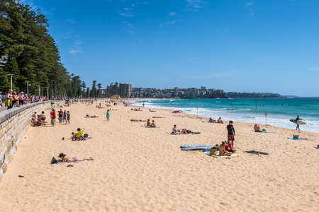 Sydney, Australia - November 9, 2014: Manly Beach on a sunny, sunday morning, with tourists and sightseers enjoying the water, Sydney, Australia. People having fun on Manly beach.
