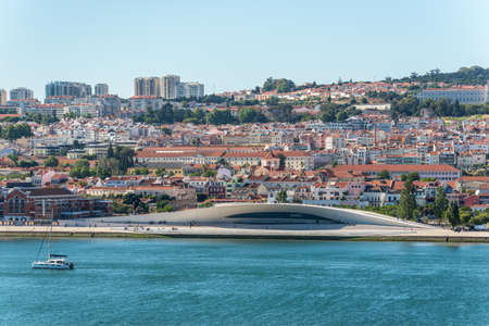 Foto per Lisbon, Portugal - May 19, 2017: View of Lisbon city from the cruise ship on the River Tagus, Portugal. Museum of Art, Architecture and Technology (MAAT) in the foreground. - Immagine Royalty Free
