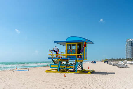 Photo for Miami, FL, United States - April 19, 2019: Miami South Beach sunshine with lifeguard tower and coastline with blue sky in Florida, USA. - Royalty Free Image