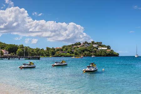 Photo pour Les Trois-Ilets, Martinique - December 13, 2018: Personal watercrafts (water scooters) at Anse Mitan Beach at Les Trois-Ilets, peninsula La Pointe du Bout, Martinique, FWI. - image libre de droit