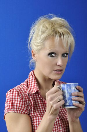 Woman drinking a hot drink