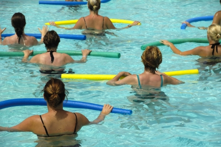 Wemen doing water aerobic in pool