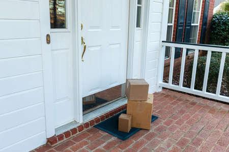 Foto de Shipping boxes on front porch of home - Imagen libre de derechos
