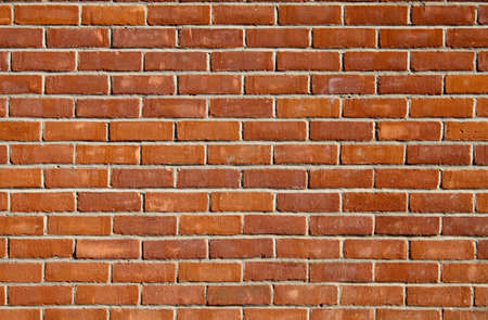 Red brick wall suitable as a background or wallpaper