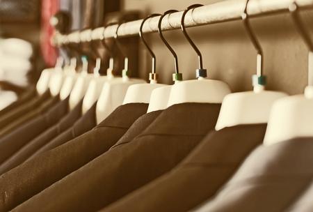 Photo pour row of elegant jackets on hangers in men clothing store - image libre de droit
