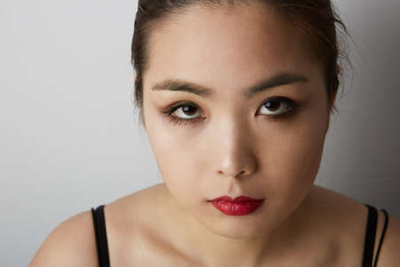 Photo pour Beauty portrait of young asian woman isolated on white background. Space for text. - image libre de droit