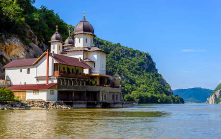"Mraconia Monastery is the only Romanian monastery built between the rocky banck of the Danube and its waters. Mraconia means ""hidden place"" or ""dark water�. It is located 15 Km west of the Romanian town Orsova"