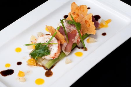 Lobster medallion with parma ham on asparagus and citrus dressing, balsamic dressing and parmesan cheese cracker