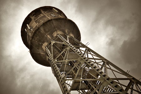 Water Tower in Nikiszowiec - coal mine worker's district of Katowice (Poland). Steel tower with concrete tank.