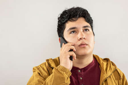 Photo pour Expression session. Young man talking on the cellphone with different facial expressions - image libre de droit